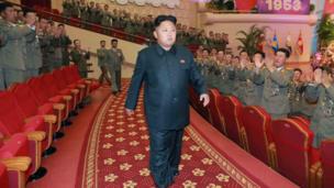 Kim Jong-un walking through a theatre.