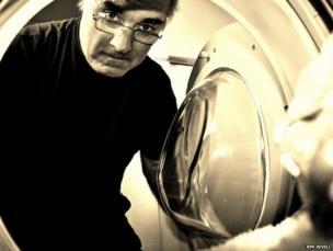 Man looking in washing machine