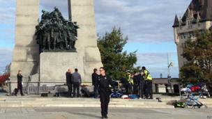Police at the scene of the shooting at the National War Memorial in Ottawa