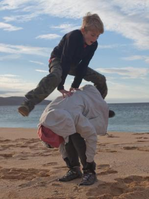 Leap frog on a beach