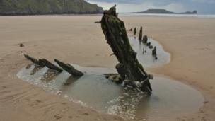 The ancient Helvetia shipwreck at Rhossili in Swansea.