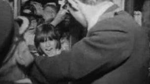 Beatles fans trying to enter the Capitol Theatre in Cardiff