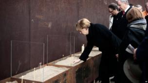 Angela Merkel lights a candle