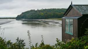 Dylan Thomas' Writing Shed in Laugharne, Carmathenshire, overlooking the estuary of the river Taf.
