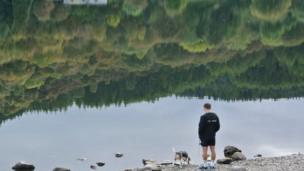 Lloyd Owen and his dog in Llyn Crafnant, Snowdonia, Conwy.