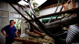 Man checks damage to his parents' home