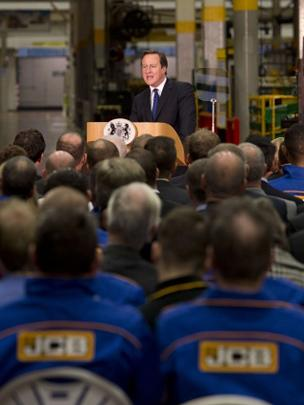 David Cameron delivers his speech in front of JCB workers