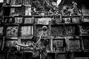 Children play in a cemetery in Manila, Philippines