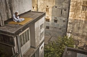 Man on a roof in Dhaka, Bangladesh