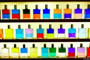 Coloured bottles on a shelf