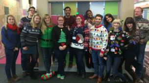 The Newsround Team wearing their Christmas jumpers