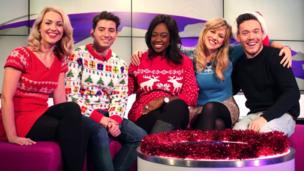 Newsround presenters in Christmas jumpers