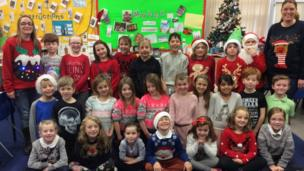 A group of school children with their Christmas jumpers