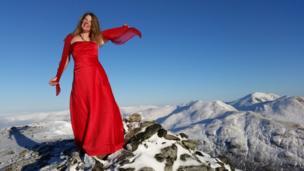Woman at summit of Meall nan Tarmachan