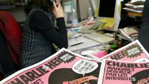 A journalist works in the Paris newsroom of French satirical weekly Charlie Hebdo, in this 2006 file photo.