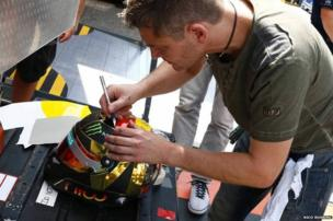Designer Jens Munser working on Nico Rosberg's helmet
