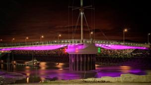 Rhyl's Pont y Ddraig bridge is illuminated in this picture by Martin Hughes, of Prestsatyn.