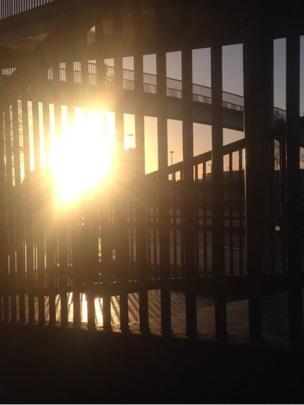 Sun shines through railings
