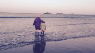 Girls standing on the beach