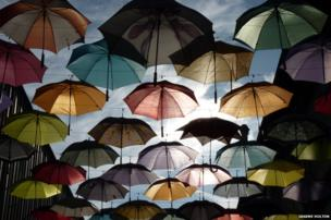 An outdoor art display of umbrellas in Zurich