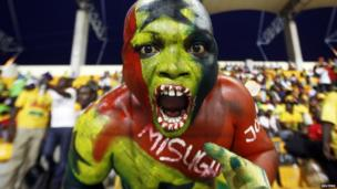 A Ghana fan cheers before their semi-final