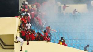 Fans flee from teargas