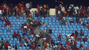 Equatorial Guinea fans react as a police helicopter hovers