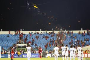 A police helicopter hovers over Equatorial Guinea fans