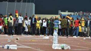 Ghana's supporters try to get out of the stadium