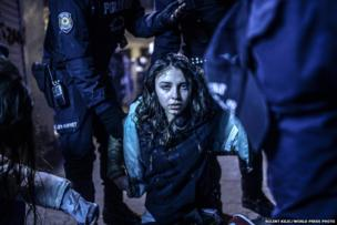 A young girl was wounded during clashes between riot police and protestors after the funeral of Berkin Elvan, a 15-year-old boy who died from injuries suffered during anti-government protests.