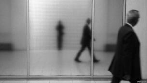 Man passing mirror