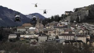 Helicopters of the French gendarmerie and emergency services fly over Seyne-les-Alpes