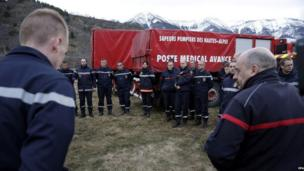 Firefighters and members of the emergency services meet at dawn