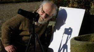 Man photographing eclipse