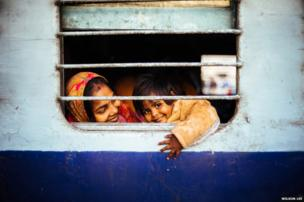 A child smiling on a train - Smile winner - Wilson Lee, Hong Kong