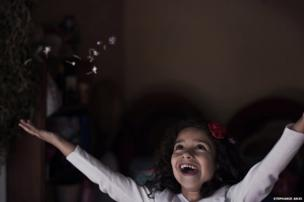 A girl cheering - Portraits winner - Stephanie Anjo, United Kingdom
