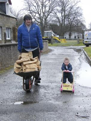 Father and son bring in firewood
