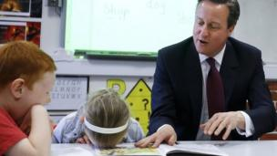 David Cameron and schoolgirl Lucy Howarth at a primary school near Bolton