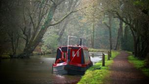 Red canal boat on the Monmouthshire and Brecon Canal