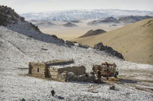 Herder Shohan's winter home - the family's possessions loaded on to a truck - copyright Timothy Allen