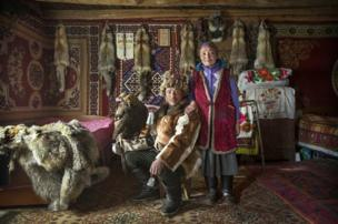 Nomadic Kazakh herder Shohan, with his wife and golden eagle - copyright Timothy Allen