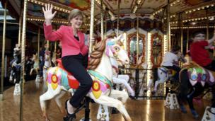 Nicola Sturgeon on a carousel