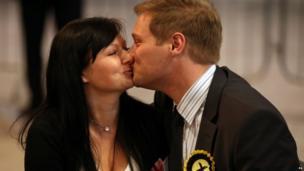 SNP's Stuart Donaldson kisses his girlfriend Lucy Emptage