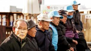 A group of pensioners gather at Gupo market in Busan.