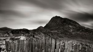 Slate fence (Crawia) with Tryfan in the background.