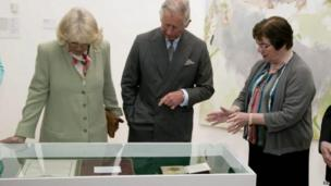 Caitriona Yeats, granddaughter of Irish poet WB Yeats, shows Prince Charles and his wife Camilla medals and scrolls belonging to her grandfather during the royal couple's visit to The Model cultural centre in Sligo