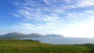 "Blue skies at Dinas Dinlle near Caernarfon, looking at the ""Three Sisters"" mountains, as seen by Rhiannon Thomas"