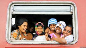 Sri Lankan family in train window