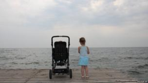 Two children looking out to sea