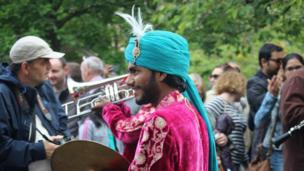 A man playing cymbals